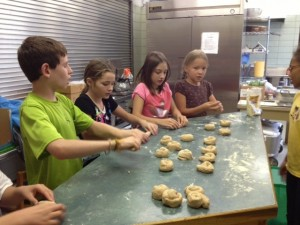 Grade Four students prepare rolls for Harvest lunch.